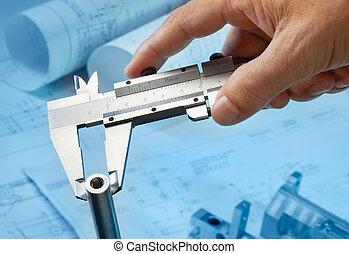using caliper - measuring machine part with caliper,...
