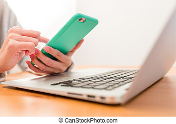 Using cellphone and laptop computer