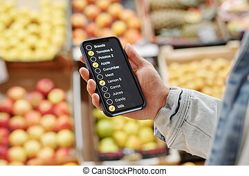 Using check-list app while buying food