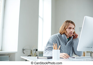 Using computer - Portrait of serious guy working with...