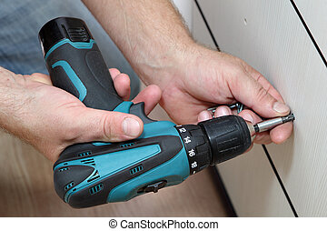 Using cordless screwdriver for screwing screws when...