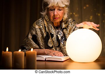 Using crystal ball - Old fortune teller is learning how to...