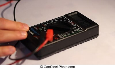 Using Electricity Multimeter - Person is using the digital...