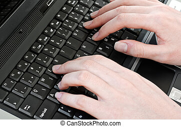 using keyboard - woman pressing keys on the laptop computer...