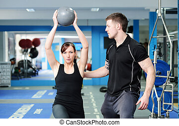 Using medicine ball with personal trainer - Personal trainer...