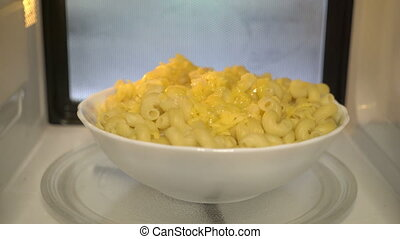 Using microwave to heat up food. Warming up cooked macaroni...