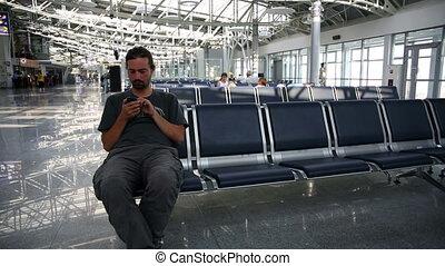 using mobile phone at airport