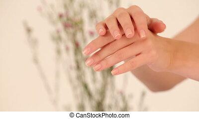 Using moisturizing cream - Woman using moisturizing cream....