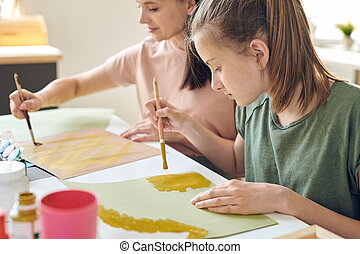 Using paints while making picture