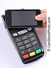 Using payment terminal with mobile phone with NFC technology, finance concept