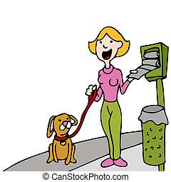 Using Pet Waste Bag Dispenser While Walking Dog