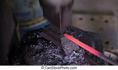 Using Pneumatic Hammer to Shape Hot Metal. Ukraine