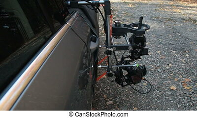 Using rig for the shots with the camera mounted on the outside of the car