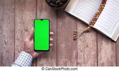 Holy book Quran and rosary on table, close up