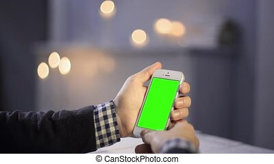 Using Smart Phone on Wood Table Various Hand Gestures Vertical Close up Green Screen