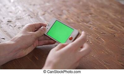 Using smart phone on wood table various hand gestures, vertical