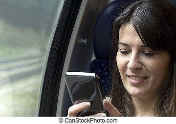 using smartphone in train