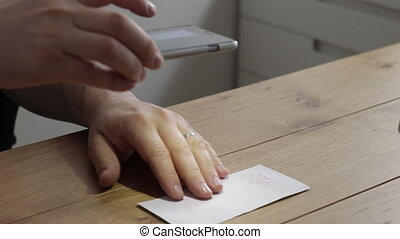 Using smartphone to mobile deposit check into bank account -...