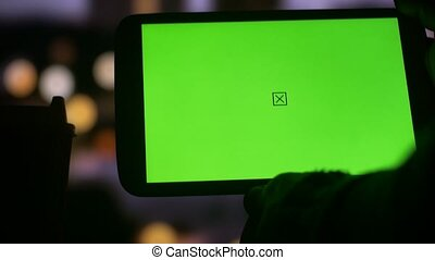 Using tablet PC with Green Screen city night bokeh background