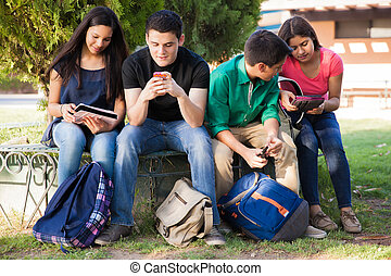 Using technology at school - Group of high school students...