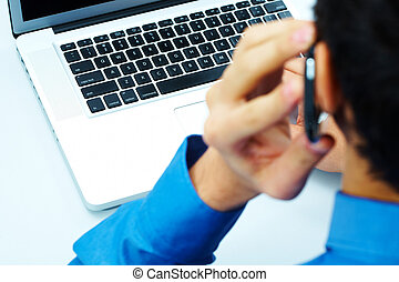 Using telecommunications - Photo of open laptop with calling...