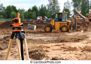 Using theodolite at construction site for land level measurement