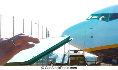 Using touch pad outdoor at the airport - Close-up shot of ...