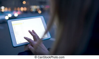 Using touchpad outdoor in the evening - Close-up shot of...