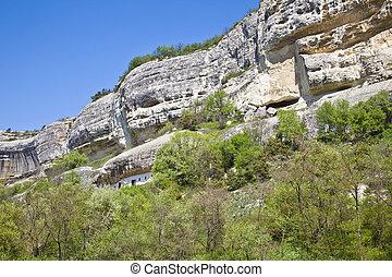Uspensky Cave Monastery. Aviary - Cut in the rock Orthodox...