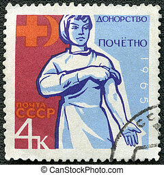 USSR - 1965: dedicated Honoring blood donors, show Hand holding carnation, and donors emblem