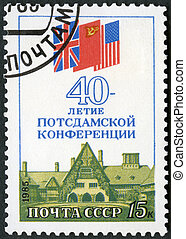 USSR - 1985: shows Caecilienhof Palace, Potsdam, Flags of...