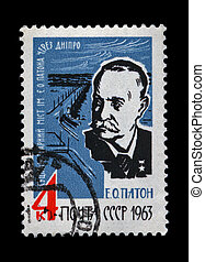 USSR - CIRCA 1963: cancelled stamp printed in the USSR, shows famous bridge over Dnieper river in Kiev (Ukraine) named of Evgeny Paton, circa 1963. vintage post stamp on black background.
