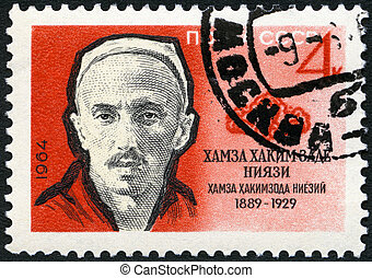 USSR - CIRCA 1964: A stamp printed in USSR shows Hamza...