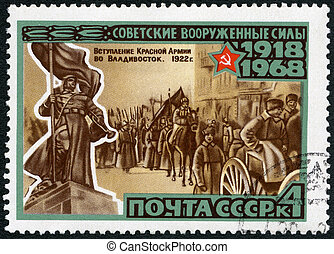 USSR - CIRCA 1968: A stamp printed in USSR shows Red Army entering Vladivostok and soldiers monument in Primorie, series 50th anniversary of the Armed Forces of the USSR, circa 1968