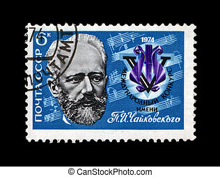 USSR - CIRCA 1974: cancelled stamp printed in the USSR, shows famous russian, soviet composer, pianist Pieter Chaikovsky, circa 1974. vintage post stamp on black background.