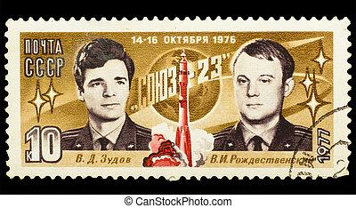 USSR - CIRCA 1977: A post stamp printed in USSR, shows russian astronauts Zudov and Rozhdestvensky, spacecraft Soyuz - 23. Circa 1977