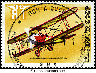 """USSR - CIRCA 1986: A stamp printed in USSR shows the Aviation Emblem """"Yak"""" and aircraft with the inscription """"Ja-1, 1981"""" , circa 1986"""