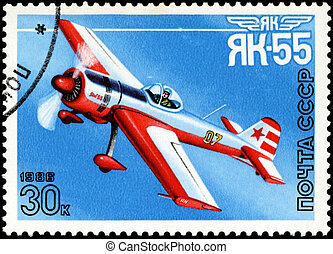 """USSR - CIRCA 1986: A stamp printed in USSR shows the Aviation Emblem """"Yak"""" and aircraft with the inscription """"Yak-55, 1981"""" , circa 1986"""