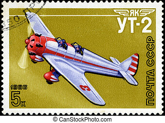 """USSR - CIRCA 1986: A stamp printed in USSR shows the Aviation Emblem """"Yak"""" and aircraft with the inscription """"UT-2, 1981"""" , circa 1986"""