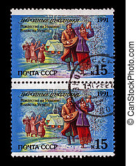 USSR - CIRCA 1991: cancelled stamp printed in the USSR, shows ukranian people dancing during Christmas holiday, tree under snow and small houses at night, circa 1991. Christmas in Ukraine as text.
