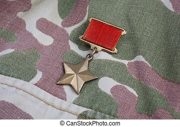 """USSR military uniform - The Gold Star medal is a special insignia that identifies recipients of the title """"Hero"""" in the Soviet Union on Soviet camouflage uniform background"""