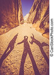 Utah Canyon Fun. Funny People Shadows in Grand Wash, Capitol...