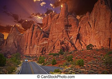 Utah Scenic Road Trip by Car. Beautiful Rock Formations Surround the Road. Destination Utah - North America Travel Photo Collection.