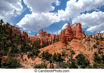 Red rock, blue sky and dark clouds contrast in this image of a southern Utah National Park.