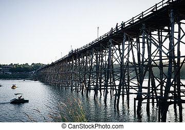 Utamanusorn Bridge (Mon Bridge), made from wooden for across the river in Sangkhlaburi District, Kanchanaburi Thailand