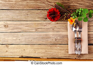 Utensils and Flowers on Table with Copy Space