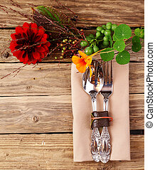 Utensils on Wooden Table with Fresh Flowers