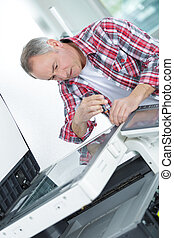utilisation, homme, tournevis, photocopieur