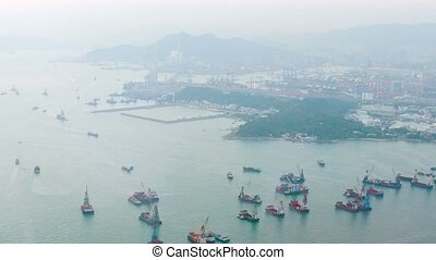 """Utility Barges in Bay of Hong Kong. - """"Overlooking, panning..."""