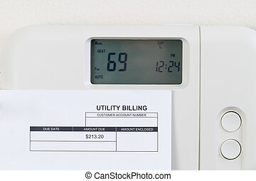 Utility bill with heating thermostat on wall